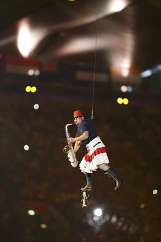 An artist performs during the pre-show at the closing ceremony of the London 2012 Olympic Games at the Olympic Stadium, August 12, 2012. REUTERS/Chris Helgren