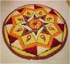 Onam Festival lasts for ten days and brings out the best of Kerala culture.View these 50 Best Pookalam Indian Floral Design and get your creative side going. Rangoli Designs Flower, Rangoli Ideas, Rangoli Designs Images, Rangoli Designs Diwali, Kolam Rangoli, Flower Rangoli, Beautiful Rangoli Designs, Free Hand Rangoli Design, Small Rangoli Design
