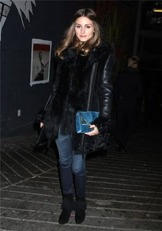 Love the black leather, fur, blue jeans, blue purse and boots...