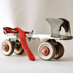 Metal roller skates  How many hours did we spend skating up and down the block on a pair of these? I couldn't even begin to count! We wore the little adjustment key on a chain or string around our necks so we didn't lose them. In the early 60's, we took the skates apart and nailed them on each end of a piece of wood for skateboards.