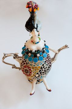Silver plated teapot , ceramic doll body parts,millefiori, vintage glass beads,ceramic tile,fimo clay