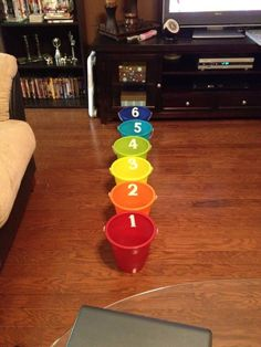 The Bucket Game - clever review game for in the classroom. Students throw a ball into a bucket designating different levels of difficulty questions. If the student gets the correct answer then their team gets the number of points corresponding to the difficulty level.