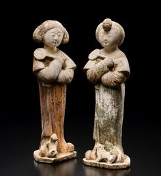 Painted white Pottery figures of two young ladies with a puppy holding a fan in their right hand. China, Tang Dynasty (618-907).    artfinding.com
