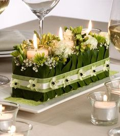candle centerpiece - 3 candles glass cylinders pushed into green oasis holes , add white Lilly of valley, add Lilly leaves, add ribbon to hold together Floral Centerpieces, Table Centerpieces, Wedding Centerpieces, Wedding Table, Wedding Bouquets, Floral Arrangements, Wedding Decorations, Christmas Decorations, Centrepieces