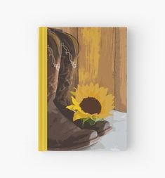Add a charming flair to the decor of your rustic chic marriage with the casual yet classy Country Sunflower Western Wedding Hard Cover Guest Book. This ranch theme wedding guest book features a digitally painted floral photograph of a pair of brown leather cowboy boots and yellow sunflower blossom with a brown barn wood background. #countrywesternwedding #guestbooks