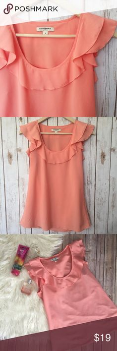 """Banana Republic coral ruffle blouse sleeveless Beautiful under a blazer or with a patterned skirt, this blouse is silky and beautiful! Gently used, but still in excellent condition! Measurements laying flat: bust 17"""", length 26"""" {RS1.RP.310317} Banana Republic Tops"""