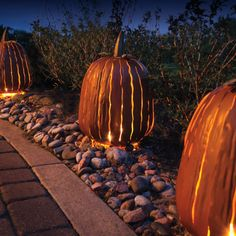 Place a candle or light inside these Metal Halloween Pumpkins and place them along the walkway to show your trick-or-treaters the way to the door.