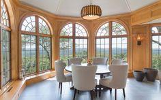 Oversized windows frame panoramic views from Aspetong Summit.