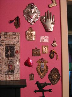 Mexican decor: hearts and milagros + mexican pink!