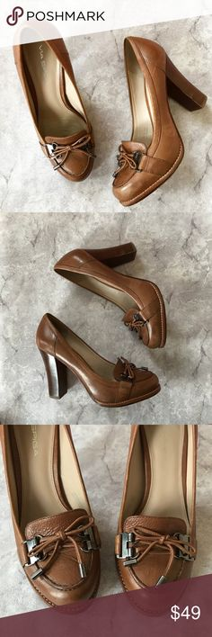 """Via Spiga Italian Leather Brown Block Heels Via Spiga Italian leather brown block heels. Heeled loafer style with cool metal and lace tie embellishments. Leather lining and upper for a super comfortable, wear-all-day shoe! • Very good used condition—only showing wear on soles • 4"""" Block heel, almond toe  • Runs true to size Via Spiga Shoes Heels"""