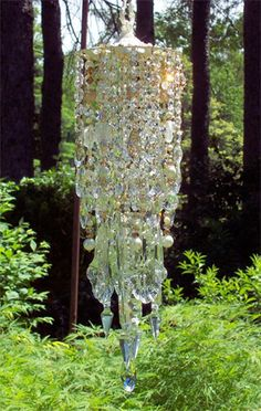 There are three layers of the most precious, dazzling crystals, glass beads, pearls and extraordinarily dazzling antique lead crystal prisms. Crystal Wind Chimes, Diy Wind Chimes, Mosaic Glass, Glass Art, Mosaic Art, Sea Glass, Stained Glass, Wine Bottle Crafts, Wine Bottles