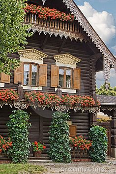 Russian House by Maigi, via Dreamstime...what did they grow up those porch pillars?