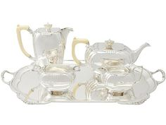 Sterling Silver Ivory Handled Four Piece Tea and Coffee Service with Tray - Art Deco - Vintage  SKU: A3367 Price  GBP £6,950.00  http://www.acsilver.co.uk/shop/pc/Sterling-Silver-Ivory-Handled-Four-Piece-Tea-and-Coffee-Service-with-Tray-Art-Deco-Vintage-97p2815.htm#.Vjnw5Ss8rfc