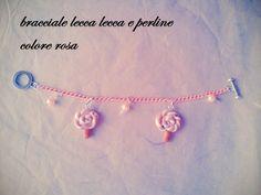 bracciale lecca lecca e perline colore rosa