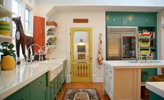 Alison Kandler's Colorful Farmhouse Kitchen. Love the yellow screen door that leads to the pantry.