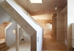 Japanese studio mA-style architects has completed a metal-clad house with a smaller wooden house i...