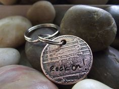 SALE Rock On Keychain etched with a music sheet by patsdesign