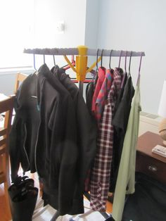 Wardrobe for Europe in the fall (part 2):   Shirts: Patagonia Merino baselayer (wool:heart); Merrell Cambia (plain); Merrell Kittredge (neon checked); Merrell Luanna (polyester flannel); misc Target poly-cotton gray hooded shirt; two Target poly-cotton C9 t-shirts  To keep warm: Black wool-blend sweater; North Face fleece; Merrell Urbaine raincoat  Misc: 1 black belt; 1 swimsuit (if needed)