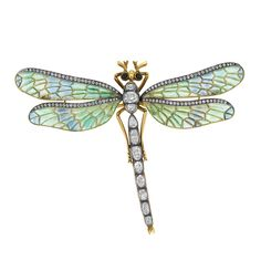 Art Nouveau Plique-a-Jour and Diamond Dragonfly Brooch  Silver, gold, centering a body set with 11 oval, pear-shaped and cushion-shaped diamonds approximately 2.30 cts., flanked by four en tremblant wings of green and blue plique-a-jour enamel, the edges set with numerous small old European-cut diamonds, the head set with 2 round cabochon black onyx eyes. With fitted box.