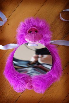 DIY baby mirror - old stuffed toy plus mirror board.  From FaerySarah.