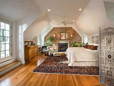 attic master bedroom. eclectic and spacious bedroom with burnished plaster exposed brick walls design mcnally interiors attic bedroomsmaster master n