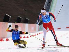 Joergen Graabak of Norway (R) narrowly beats Fabian Riessle of Germany in the Nordic Combined Men's Team 4 x 5 km. Sochi 2014 - Best of Day 14.