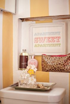 I want our bathroom to have these items. Definitely going to make that picture, and steal the mirror tray idea.