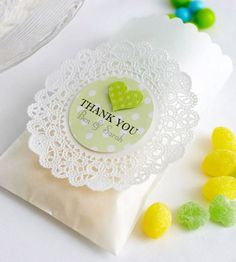 Favor Bags Purchased glassine bags can be easily dressed up by adding a decorative top edge to each one with a border punch. A paper doily and circle-punched sentiment lend simple elegance.