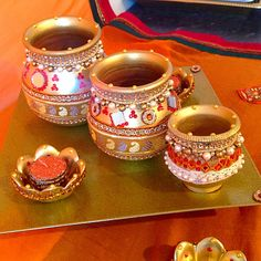 A traditional indian gift plate with decorated pots.
