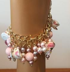 This one of a kind bracelet features a gold plated chain with magnetic clasp. An adorable lampwork heart with daisies is surrounded by Swarovski pearls in pale pastels and sweet porcelain tea cups. 7