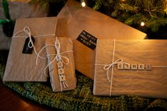 Kraft paper with chalkboard and scrabble tile tags. What a great way to wrap gifts and cute too! #christmas #holiday