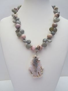 Unique necklace with pin opal, labradorite and free form pink opal pendant with antique pewter sea horse. Necklace is long, plus pendant drop, free pair of earrings are long with leverback. Handmade Jewellery, Silver Jewellery, Handcrafted Jewelry, Sterling Silver Jewelry, Summer Necklace, Summer Jewelry, Statement Necklaces, Unique Necklaces, Minions