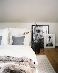 Bedroom interior inspiration includes a low bed draped in luxe white bedding, a fur comforter and layered frames. Serene Bedroom, Home Bedroom, Modern Bedroom, Master Bedroom, Bedroom Decor, Girls Bedroom, Bedroom Ideas, Budget Bedroom, Bedroom Black