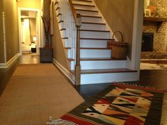 Layering rugs is a great idea for odd entryways. By LarissaChaneyInteriors
