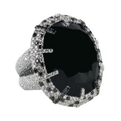 34.85 ct. cushion black diamond ring in 18k gold microset with 768 black and white diamonds; $58,000 ; Martin Katz, Los Angeles