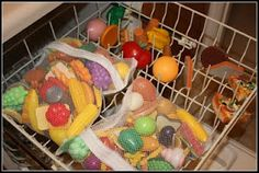 Use delicate laundry bags to wash toys in dishwasher. This way they do not fall to the bottom of dishwasher. Also do not dry them in the dishwasher as they might melt.