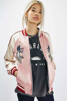 This unique unpadded bomber jacket comes in a reversible style, giving you the ability to switch between pale pink and baby blue with every wear. Featuring cool Oriental inspired pattern to the front and back. #Topshop