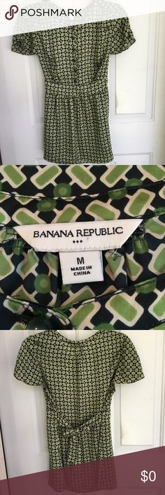 "Banana Republic Top Banana Republic Top. Size medium (100% polyester). Green print. Button front, short sleeves and banded front waist with tie back. Gathered detailing at shoulder, sleeves & back neckline. Great condition. 🌸 Approximate Measurements: Pit to pit-19""; Shoulder edge to shoulder edge (where sleeve attaches)-15""; Front waist band (side seam to side seam)-16 1/4""(back waist width approx-19""/tie back for fit); Bottom Hemline Width (flat)-22 3/4""; Length (from back neckline to…"
