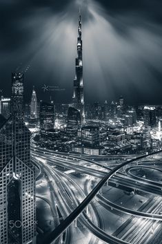 The world is a book, and those who do not travel read only one page. Dubai City, Dubai Uae, Warsaw City, Contemporary Photography, Burj Khalifa, Empire State Building, Cool Places To Visit, Beautiful Places, Skyline