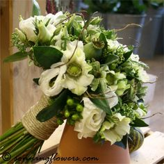 Pretty rustic green and white bouquet with curly willow