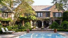 To give the pool terrace of an English-style house in Houston, Texas, a serene, orderly feel, designer Ginger Barber used clean-lined Janus et Cie furniture.   - HouseBeautiful.com