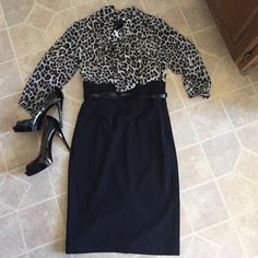 Fabulous WHBM dress The skirt of the dress is high waisted and fits like a pencil skirt. The top part of the dress is in a fun animal print. Great to wear to work or for a night out. Still has tags attached. Never worn. White House Black Market Dresses