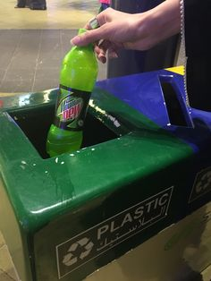 In this photo i have taking a photo for my sister who through her soft drink after when she finish it on the plastic recycling rubbish.