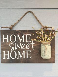 "Rustic Outdoor Home Sweet Home Sign  Great for hanging outside your home or indoors.  Makes a great housewarming gift for any home.  - Size is approximately 12 X 18 inches.  Depth is approximately 5"" with the Mason jar. - Comes ready to hang - Light sealer applied - New wood used -Flowers are NOT included - Custom font color (you pick)  FONT COLORS: Tan, Blue, Yellow, Teal, Barn Red, or a light green."