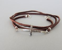 This sterling cross bracelet with a leather wrap has a bit of a rustic flair.    This is my new favorite bracelet, so simple and such a big statement!