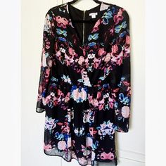 🎉 Fun & Flirty Dress Worn once and bought here at Posh. Great condition! Love the popping flower print and light fabric. Zippered back and mid-sides is lace material. Ask questions before purchasing. Size LARGE 🎉                           📦 Fast Shipper! ✅ Open to Negotiate & Bundles. 💝 Free Gift with Purchase! 🚫 Smoke-free/ Pet-free home. 💯 All Sales Final.  ❌ No Trades. No Paypal. Xhilaration Dresses