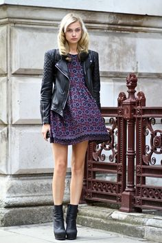 Girly dress with leather jacket.
