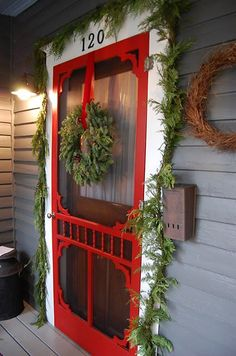 Christmas Home Tour: Tour A Beautiful Folk Victorian I love this style of screen door and it is perfect for decorating with all simple natural Christmas decorations Country Christmas, All Things Christmas, Winter Christmas, Christmas Home, Merry Christmas, Christmas Crafts, Christmas Decorations, Natural Christmas, Outdoor Christmas