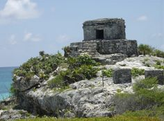 Mayan Ruins at Tulum: It amazes me that the temple was created as a warning system for hurricanes. Such a beautiful place.