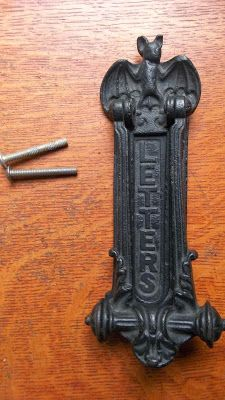 NEED THIS. Goth Shopaholic: Gothic Antiques for Dark Home Decor - Bat door knocker and mail slot cover